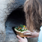 Baking pizza in a cob oven at the Nisga'a Garden